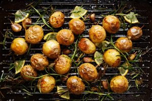 Roasted potatoes with rosemary, garlic, lemon and sea salt on a grilled pan