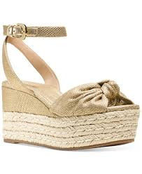 Michael Kors Maxwell cut from neutral-hued hemp, they are detailed with soft nappa leather and textured jute trim.