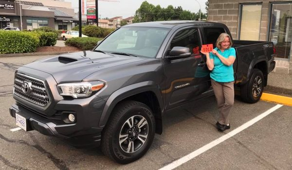 Cathy taking ownership of her new vehicle.